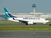 Photo: WestJet, Boeing 737-700, C-FIWJ