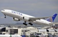Photo: United Airlines, Boeing 777-200, N229UA